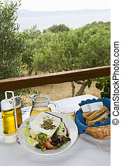 greek salad with house wine taverna with view