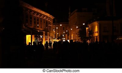 Night Crowdy Downtown - Lot of people silhouettes rushing in...