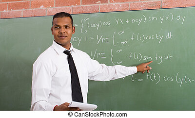 teacher teaching - maths teacher writing on the board