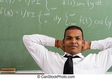 relaxed maths male teacher - a male maths teacher relaxing...