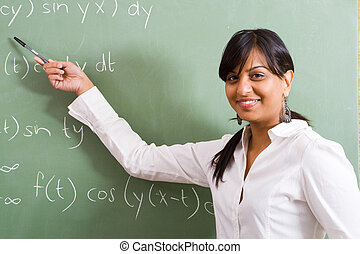 maths teacher - lovely maths teacher showing her class how...