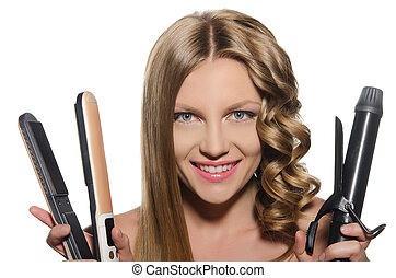 Woman holds curling iron - Young woman with smile holds...