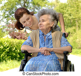 woman in a wheelchair - Senior woman in a wheelchair with...