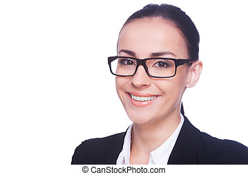 Portrait of success. Cheerful young woman in formalwear and eyeglasses looking at camera and smiling while standing isolated on white