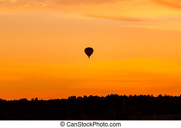 Hot air balloon flying at sunset sky - Hot air balloon...