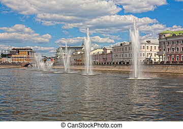 Moscow, fountains in the drainage channel in a summer sunny...