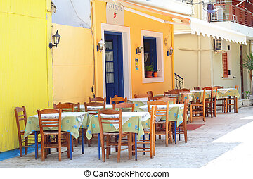 Traditional greek taverna in the streets of Lefkada Town in...