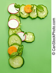 F letter made of raw vegetables