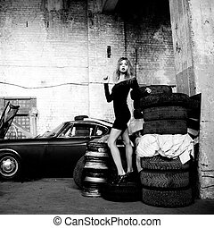fashionable woman in retro garage - picture of fashionable...
