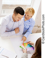 couple looking at blueprint and color samples - home, design...