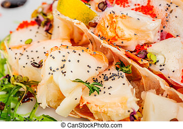 Lobster salad in japanese style with poppy seeds