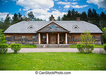 Old rural house with wooden roof near Bialystok, Poland