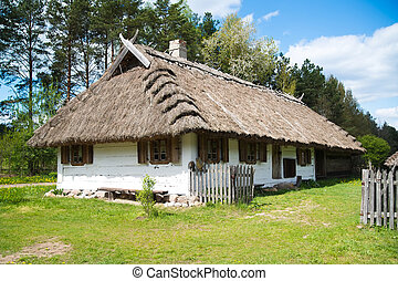 Old rural house with thatched roof near Bialystok, Poland