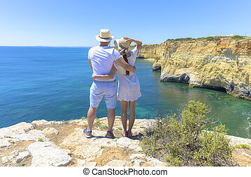 Couple enjoying the ocean view from a cliff