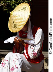 Classical Chinese Costume Girl with Hat - A shot of a...