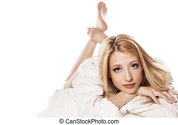 seduction - blonde girl with long hair lying seductively on...