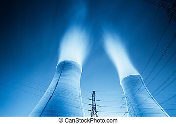 cooling towers at night - upward view of the cooling towers...