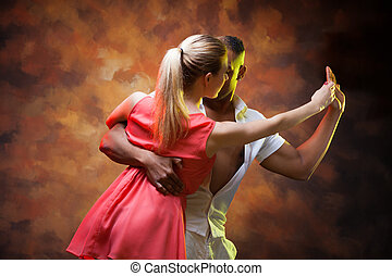 Young couple dances Caribbean Salsa - Young and sexy couple...