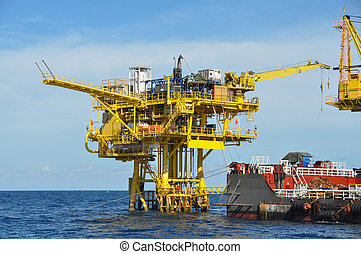 barge and tug boat in open sea,Oil and gas platform in the...