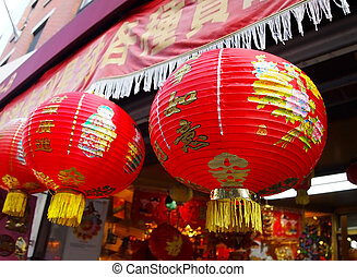Chinese Paper Globe Lanterns - A few brightly decorated red...