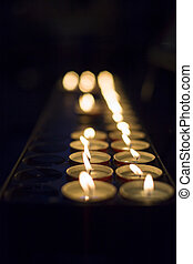 Wax candlelights giving light in the dark - Candlelights in...