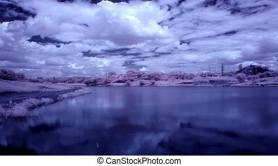 clouds over the reservoir - InfraRed landscape: Movement of...