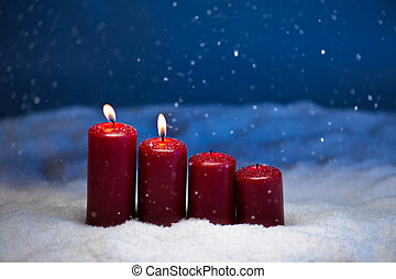 2nd Advent candles in snow and snowfall