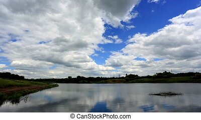 clouds over the reservoir - Movement of clouds over the...