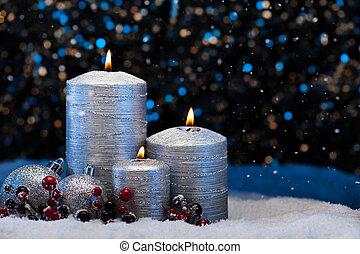 Three Silver Candles in snow