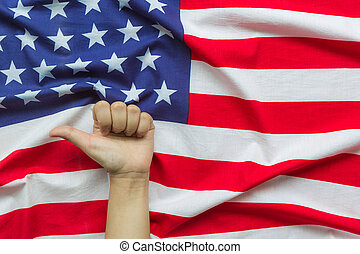 Hand over American flag