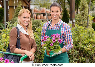 Smiling customer and worker in garden center