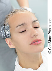 Hair Dyeing - Beautiful young woman getting a hair dyeing in...