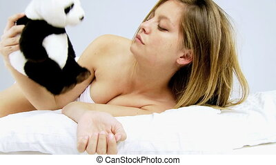 Woman sleeping with panda plush - Gorgeous woman hugging toy...