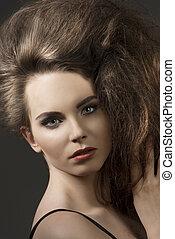 close-up of girl with voluminous hair - close-up shoot of...