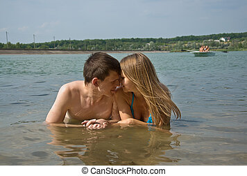 couple near lake - Happy young couple bathing in a beautiful...