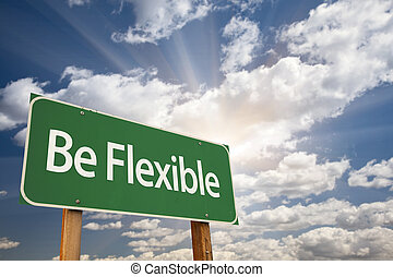 Be Flexible Green Road Sign with Dramatic Clouds and Sky.