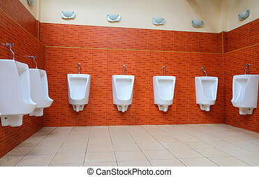 White porcelain urinals in gents toilets