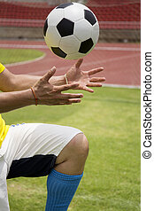 Soccer'hands reaching the foot ball - Soccer'hands reaching...