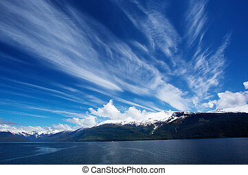 Alaskan Sky and snow topped mountain in Turnagain Arm