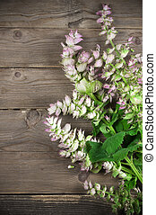 Sage bouquet lying on wooden background