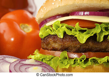 hamburger with ingredients - burger with tomato, onions,...