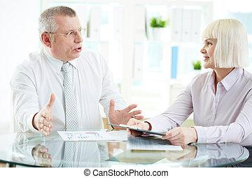 Business conversation - Portrait of mature businesswoman...