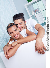 Young couple - Image of young guy and his girlfriend looking...