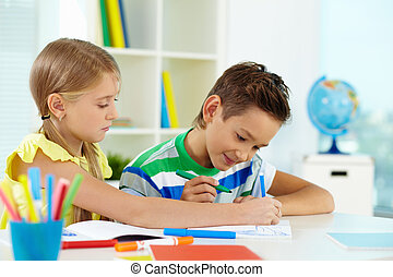 Drawing together - Lovely girl and her classmate drawing...