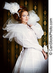 aristocracy - Beautiful fashion model in the refined white...
