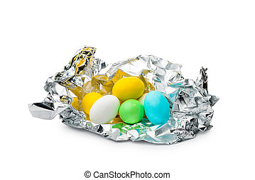 Colored Eggs - Little colored sugar and chocolate eggs in...