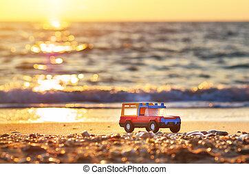 Toy on sea shore. Nature conceptual compositon.