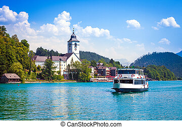 Water bus crossing Wolfgangsee and arriving in St. Wolfgang,...