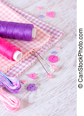 Sewing items with a check fabrics, buttons, thread and pins...