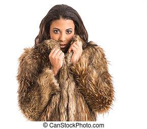 mixed race girl in fur coat - beautiful young girl keeping...
